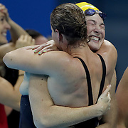 Swimming - Olympics: Day 1  Sister Bronte Campbell and Cate Campbell, (facing), hug after winning gold along with team mates Emma McKeon and Brittany Elmslie, after winning the gold medal in world record time in the Women's 4 x 100m Freestyle Relay Final during the swimming competition at the Olympic Aquatics Stadium August 6, 2016 in Rio de Janeiro, Brazil. (Photo by Tim Clayton/Corbis via Getty Images)