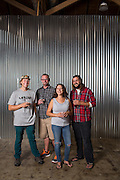 Co-owners Grant Kjos, Dietrich Wahlstrand, Michele Willaford, and Mike Willlaford, from left to right, pose for a portrait at Uproar Brewing Co. in San Jose, California, on September 2, 2015. (Stan Olszewski/SOSKIphoto)