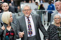 © Licensed to London News Pictures. 09/05/2014. London, UK. Artist and television personality, Rolf Harris arrives at Southwark Crown Court in London with his wife Alwen Hughes and daughter Bindi Harris on 9th May 2014. Rolf Harris has been charged with 16 counts of indecent assault on teenage girls and of making indecent images of children.. Photo credit : Vickie Flores/LNP