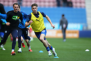 Wigan Athletic midfielder Joe Williams (20) warming up during the EFL Sky Bet Championship match between Wigan Athletic and Nottingham Forest at the DW Stadium, Wigan, England on 20 October 2019.