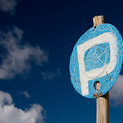 Weathered old circular parking sign on blue sky (Gorkhi-Terelj national park, Mongolia - Sep. 2008) (Image ID: 080917-1016061a)