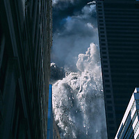Tower One falls after a jet plane was flown into it in a terrorist attack on the World Trade Center, New York City, September 11, 2001. Photo by Lisa Quinones.