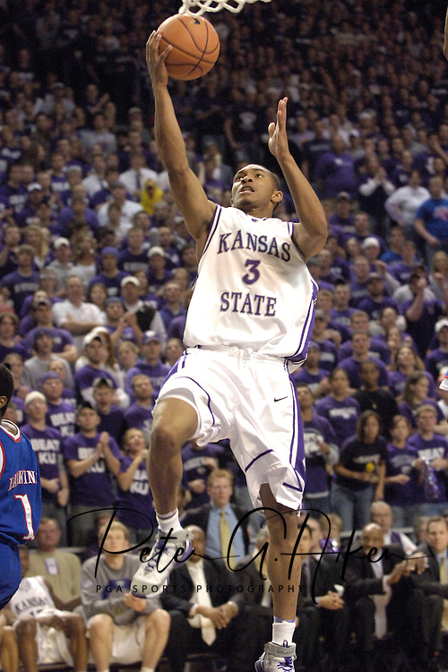 Kansas State guard Lance Harris drives in for the basket against Kansas, during the second half at Bramlage Coliseum in Manhattan, Kansas, March 4, 2006.  The Jayhawks won 66-52.