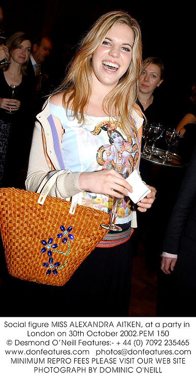 Social figure MISS ALEXANDRA AITKEN, at a party in London on 30th October 2002.PEM 150