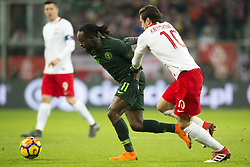 March 23, 2018 - Wroclaw, Poland - Victor Moses of Nigeria fights for the ball with Grzegorz Krychowiak of Poland during the international friendly match between Poland and Nigeria at Wroclaw Stadium in Wroclaw, Poland on March 23, 2018  (Credit Image: © Andrew Surma/NurPhoto via ZUMA Press)