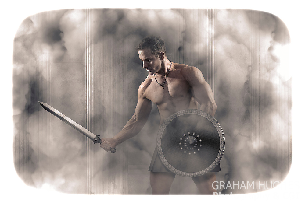 Muscular male with sword and shield in Roman environment.