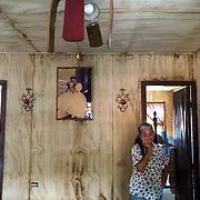 OCTOBER 13 - ADJUNTAS, PUERTO RICO - <br /> Liz Marin Sierra, 72, and daughter Rosana Aviles, 49, stand in the living room of her hurricane destroyed house in the Barrio Juan Gonzalez after the wind took off part of the room and water damaged the brand new wood panel walls in her house during  the path of  Hurricane Maria. <br /> (Photo by Angel Valentin/Freelance)