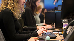 Embargoed to 0001 Monday April 30 File photo dated 07/01/16 of office workers at their desks, as law firm Clyde & Co have said that women account for a quarter of higher rate taxpayers Ð those declaring an income between £43,000 and £150,000 Ð in each of the last seven financial years.