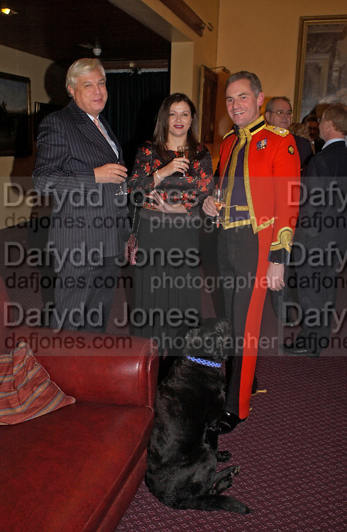 Mr. and Mrs. John Simpson and Col Valentine Woyka. , Reception to support the Hyde Park Appeal for Liberty Drives ( a charity which enables people to travel around Hyde Park in electric buggies) in the presence of Prince Michael of Kent. Officers Mess. Household Cavalry Mounted Regiment. Hyde Park Barracks. 30 November 2004. ONE TIME USE ONLY - DO NOT ARCHIVE  © Copyright Photograph by Dafydd Jones 66 Stockwell Park Rd. London SW9 0DA Tel 020 7733 0108 www.dafjones.com