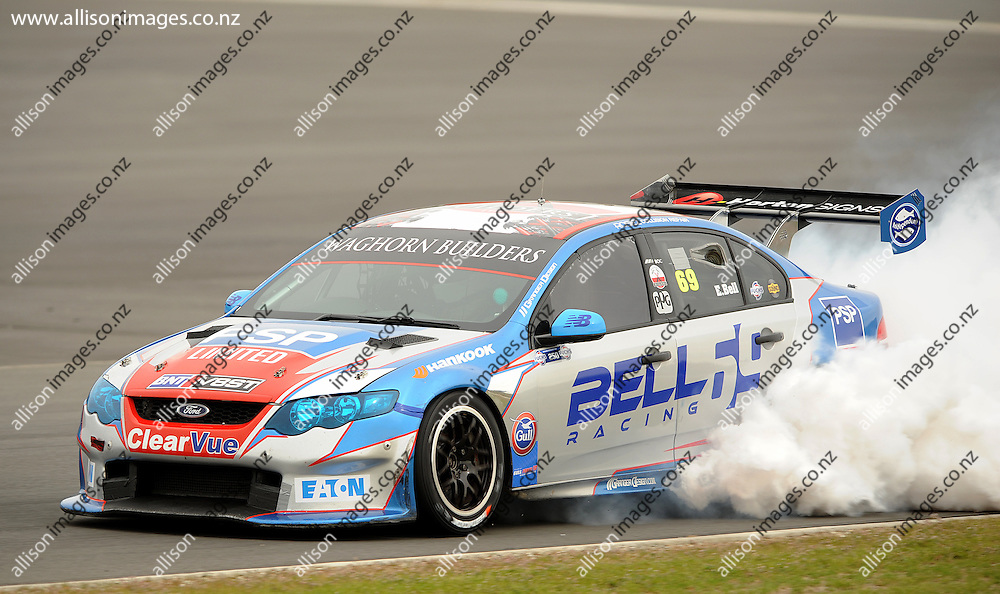 Eddie Bell of Christchurch lets off smoke, during the Highlands BNT V8 SuperTourers, held at Highlands Motorsport Park, Cromwell, Otago, New Zealand. 25 January 2014. Credit: Joe Allison / allisonimages.co.nz