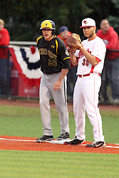 25 May 2013:  Garrett Bayliff takes first next to first baseman Kyle Stanton during an NCAA division 1 Missouri Valley Conference (MVC) Baseball Tournament game between the Wichita State Shockers and the Illinois State Redbirds on Duffy Bass Field, Normal IL