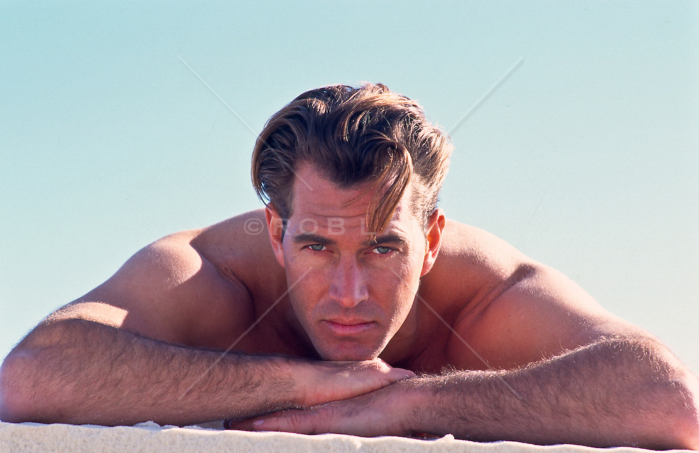 Good looking man with arms folded looking at camera