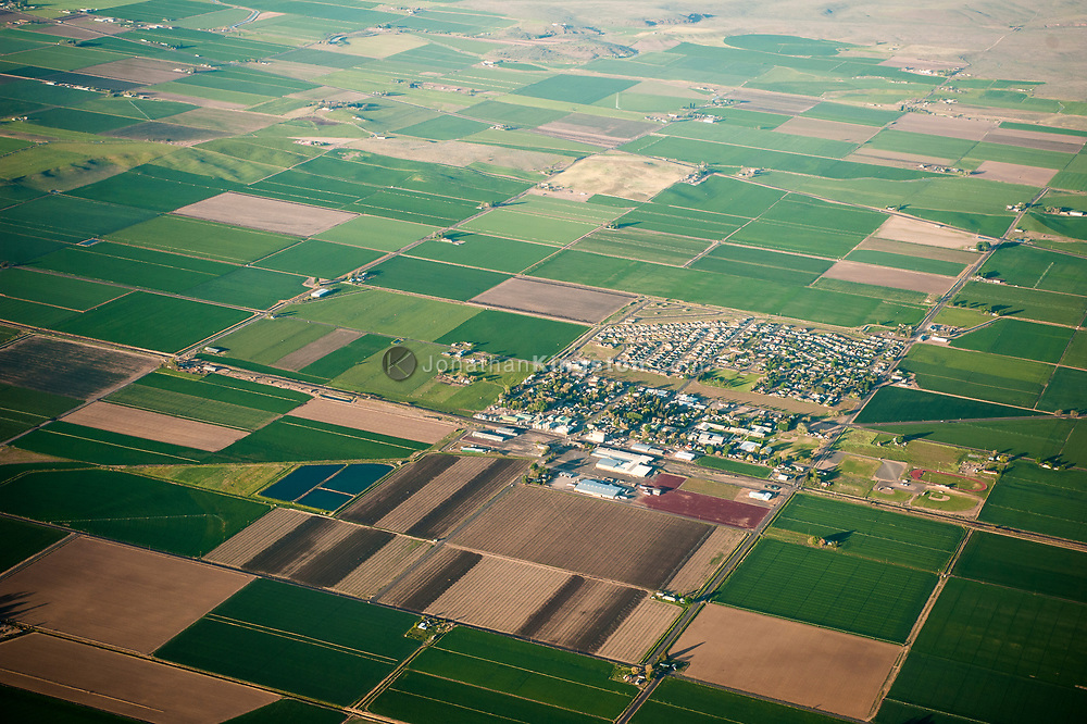 Aerial view of farm land and a small farming community in Oregon.