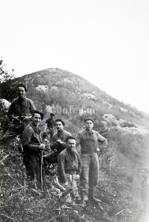group of adult men casually mountaineering France 1940s