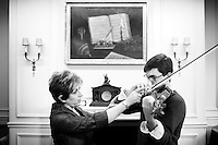 Violin faculty member Ida Kavafian (left) works on technique with student Ben Beilman during a teaching session at the Curtis Institute of Music in Philadelphia on December 7, 2009.