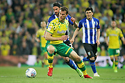 Norwich City defender Christoph Zimmermann (6)  shields the ball from Sheffield Wednesday midfielder George Boyd (21) during the EFL Sky Bet Championship match between Norwich City and Sheffield Wednesday at Carrow Road, Norwich, England on 19 April 2019.