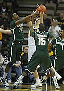 February 2 2011: Michigan State Spartans forward Delvon Roe (10), Iowa Hawkeyes forward Zach McCabe (15), and Michigan State Spartans guard Durrell Summers (15) battle for the ball during the first half of an NCAA college basketball game at Carver-Hawkeye Arena in Iowa City, Iowa on February 2, 2011. Iowa defeated Michigan State 72-52.