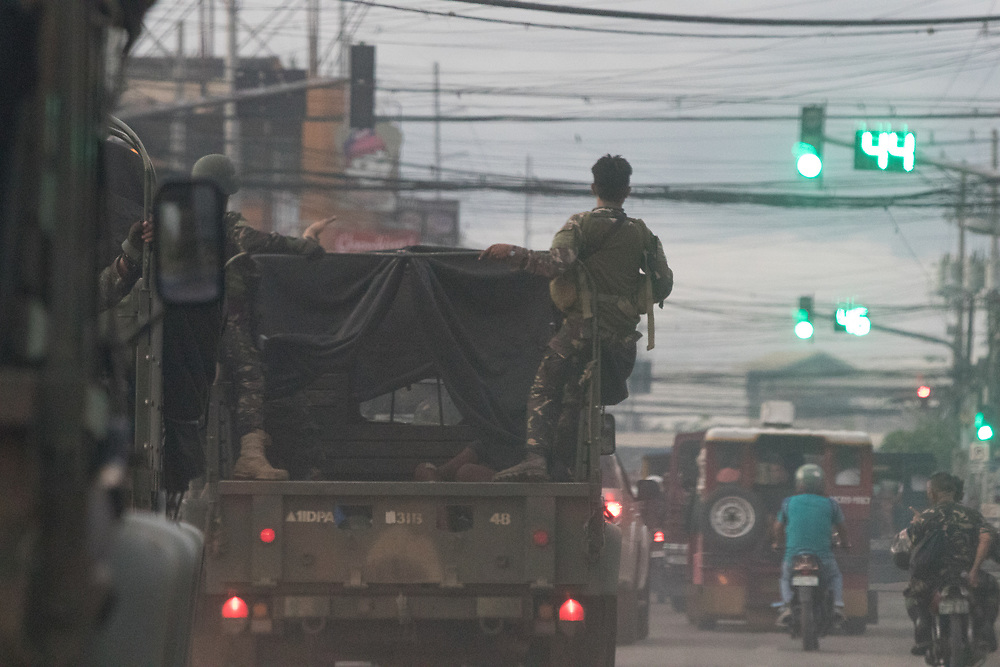 MARAWI, PHILIPPINES - JUNE 9: A truck loaded with wounded Philippines marines rush to hospital following a heavy fight between Islamic rebels and the Philippine troops in Marawi, southern Philippines on June 9, 2017. Philippine military jets fired rockets at militant positions on Friday as soldiers fought to wrest control of the southern city from gunmen linked to the Islamic State group.(Photo: Richard Atrero de Guzman/NUR Photo)