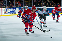 KELOWNA, CANADA - JANUARY 10: Kyle Topping #24 of the Kelowna Rockets back checks Tyson Helgesen #6 of the Spokane Chiefs as he passes the puck during first period on January 10, 2017 at Prospera Place in Kelowna, British Columbia, Canada.  (Photo by Marissa Baecker/Shoot the Breeze)  *** Local Caption ***