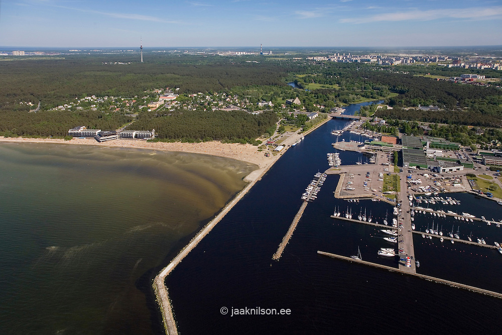 Marina at Pirita River Mouth in Tallinn, Estonia. Aerial view. Pier, Breakwater, Jetty and Forest. Baltic Sea.