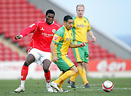 London - Saturday, January 12th, 2008: Kayode Odejayi of Barnsley and Jon Otsemobor of Norwich City during the Coca Cola Champrionship match at Oakwell, Barnsley. (Pic by Paul Hollands/Focus Images)