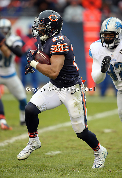 Chicago Bears running back Matt Forte (22) runs away from Detroit Lions defensive tackle Caraun Reid (97) on a third quarter running play during the NFL week 17 regular season football game against the Detroit Lions on Sunday, Jan. 3, 2016 in Chicago. The Lions won the game 24-20. (©Paul Anthony Spinelli)