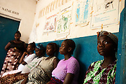 Pregnant women wait for prenatal consultation at the Tombodu PHU in Tombodu, Sierra Leone on Wednesday March 17, 2010.