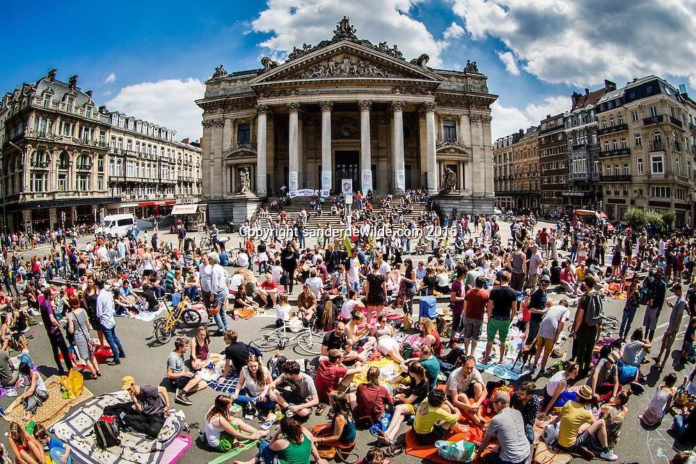20150607 Brussels Belgium a few hundred protesters occupy the center of Brussels. This urban picknick is to gain a carfree city center. This will actually happen in a few months after protests like these, but for these people changes aren't enough.