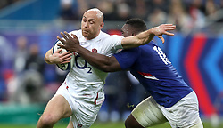 England's Willi Heinz is tackled by France's Demba Bamba during the Guinness Six Nations match at the Stade de France, Paris.