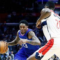 09 December 2017: LA Clippers guard Lou Williams (23) drives past Washington Wizards center Ian Mahinmi (28) during the LA Clippers 113-112 victory over the Washington Wizards, at the Staples Center, Los Angeles, California, USA.