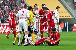 03.04.2010,  Rhein Energie Stadion, Koeln, GER, 1.FBL, FC Koeln vs 1. FC Nuernberg, 28. Spieltag, im Bild: Youssef Mohamad (Koeln #3) (R) am Boden soll den ebenfalls am boden liegenden Andreas Wolf (Nuernberg #5) (L) getreten haben. Sofort stuermen die Spieler dazu. Schiedsrichter Florian Meyer ist auch direkt vor Ort  EXPA Pictures © 2011, PhotoCredit: EXPA/ nph/  Mueller       ****** out of GER / SWE / CRO  / BEL ******
