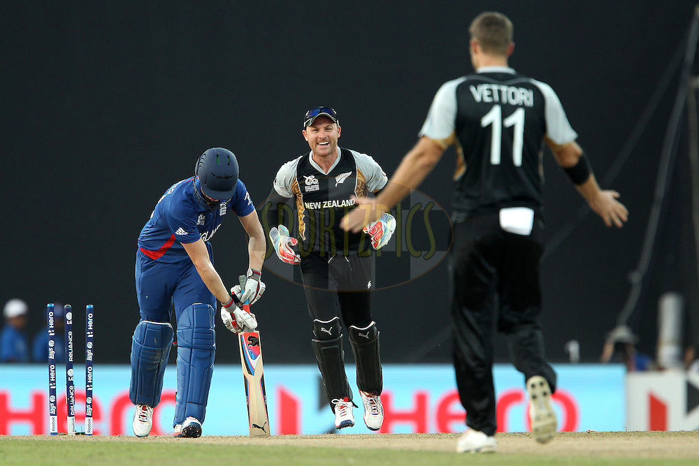 Craig Kieswetter of England departs as Brendon McCullum and Daniel Vettori celebrate his wicket during the ICC World Twenty20 Super 8s match between England and New Zealand held at the  Pallekele Stadium in Kandy, Sri Lanka on the 29th September 2012..Photo byRon Gaunt/SPORTZPICS/PHOTOSPORT