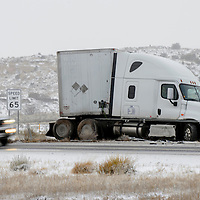 A tractor trailer sits idle in the median of Interstate 40 after careering off the road near exit 20 in Gallup Monday