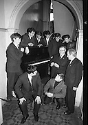 "Messrs. Pigott and Co. Ltd, handed over a piano to a group of students, calling themselves ""The Hooligans"".  The students will push the piano to Cork, with the boys playing it on route and collecting on behalf of old age pensioners. Picture shows Mr. Michael Tobin, Pigott and Co., presenting the piano keys to Mr. W.J. Martin, who accepted them on behalf of the students who will push the piano; T. Conroy, D. Cullinane, S. Martin, M. Thunder, P. Frusco and Raymond Clancy..14.03.1964"