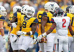 Sep 12, 2015; Morgantown, WV, USA; Liberty Flames running back D.J. Abnar (2) and West Virginia Mountaineers safety Karl Joseph exchange words after a play during the second quarter at Milan Puskar Stadium. Mandatory Credit: Ben Queen-USA TODAY Sports