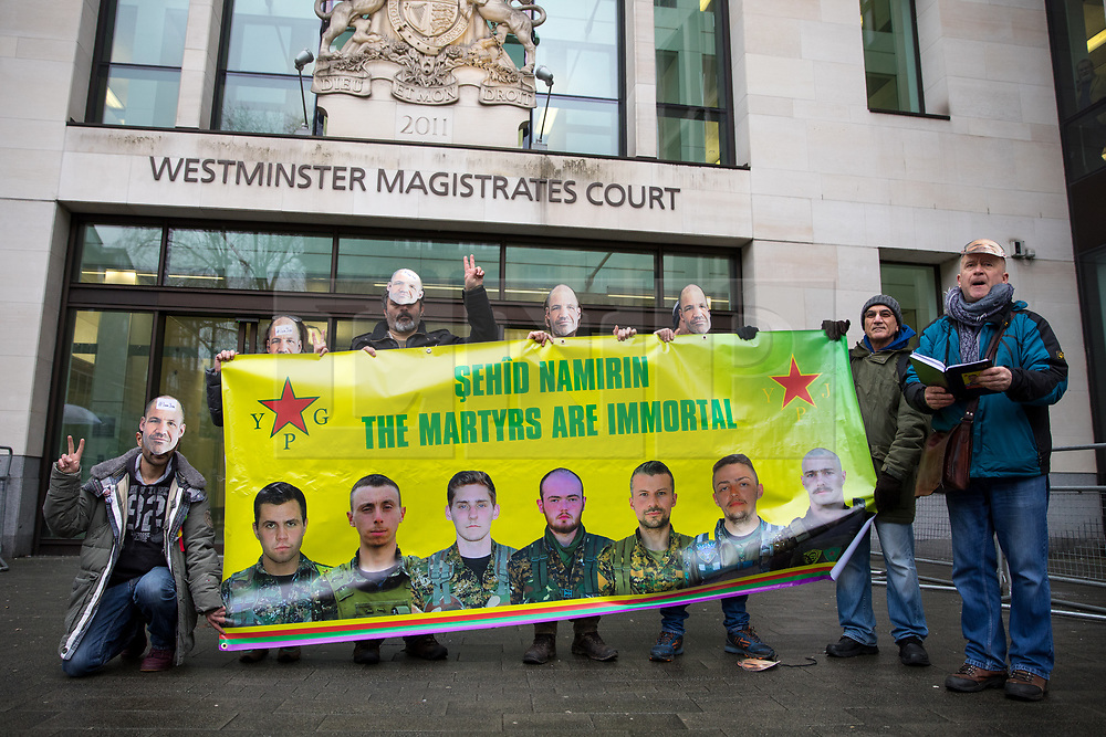© Licensed to London News Pictures. 14/02/2018. London, UK. Demonstrators supporting James (Jim) Matthews demonstrate outside Westminster Magistrates Court whilst he appears charged with one count of 'attending a place used for terrorist training', under section 8 of the Terrorism Act 2006. The former British Army soldier fought with Kurdish forces - the YPG - against ISIS in Syria. Photo credit : Tom Nicholson/LNP