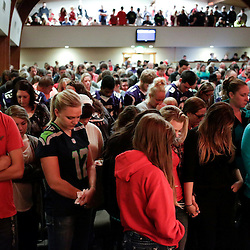 People pray during a community vigil at the Grove Church following a shooting at Marysville-Pilchuck High School in Marysville, Washington October 24, 2014. A student fatally shot one classmate and wounded four others when he opened fire in the cafeteria of his Washington state high school on Friday, following a fight with fellow students, authorities said. The shooter took his own life as Marysville-Pilchuck High School students scrambled to safety in the latest outburst of deadly violence at an American school. REUTERS/Jason Redmond   (UNITED STATES)