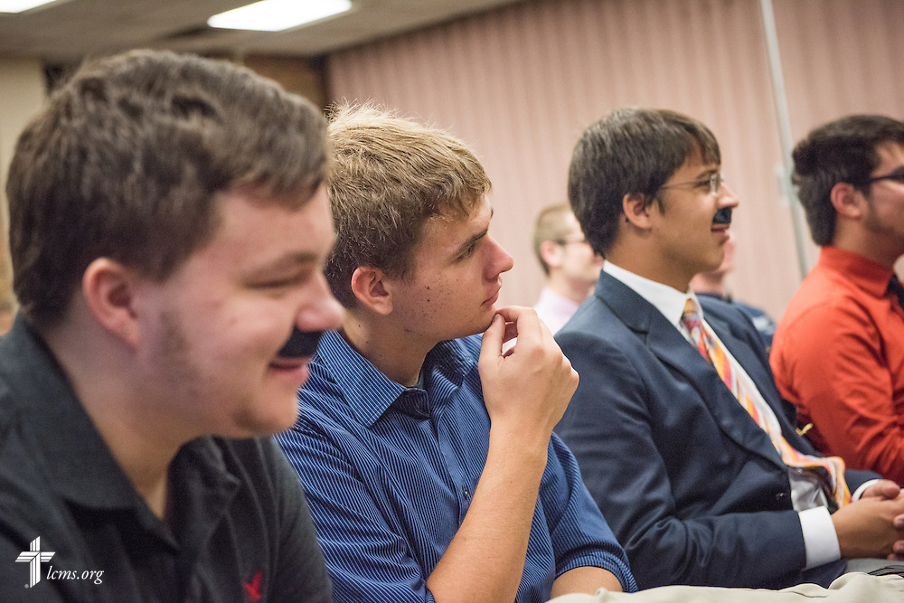 Pre-Seminary Program students, some adorned with faux mustaches, listen to the Rev. Dr. Matthew C. Harrison, president of The Lutheran Church–Missouri Synod, during a brief meeting on the university campus in River Forest, Ill., on Sunday, Oct. 12, 2014. LCMS Communications/Erik M. Lunsford