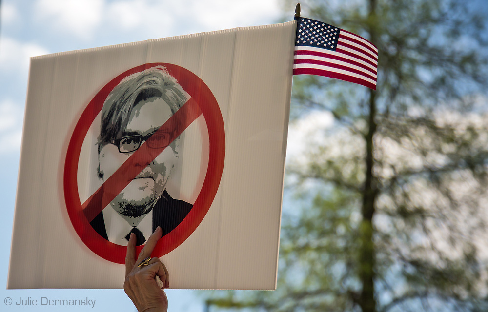 Anti Steve Bannon, Trump's chief strategist on a sign with an American flag at a Metairie Indivisible protest in front of Senator Cassidy's office in Metairie, LA.