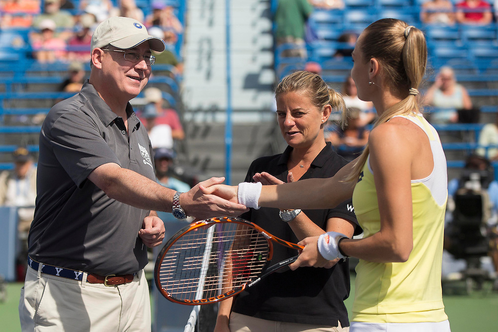 August 23, 2014, New Haven, CT:<br /> Magdalena Rybarikova shakes hands with Charlie Gill of United Technologies during a coin toss ceremony before the singles final on day nine of the 2014 Connecticut Open at the Yale University Tennis Center in New Haven, Connecticut Saturday, August 23, 2014.<br /> (Photo by Billie Weiss/Connecticut Open)