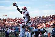 LITTLE ROCK, AR - OCTOBER 18:  Chris Conley #31 of the Georgia Bulldogs is lifted in the air after scoring a touchdown against the Arkansas Razorbacks at War Memorial Stadium on October 18, 2014 in Little Rock, Arkansas.  The Bulldogs defeated the Razorbacks 45-32.  (Photo by Wesley Hitt/Getty Images) *** Local Caption *** Chris Conley