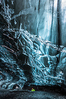 Photographer inside an Ice Cave in Breiðármerkurjökull Glacier, Southeast Iceland.