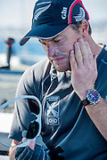 Emirates Team New Zealand trimmer Glenn Ashby ensures a good aplication of sunscreen before racing on day two of the Extreme Sailing Series at Nice. 3/10/2014