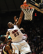 "Mississippi's Reginald Buckner (23) dunks over Mississippi State's Arnett Moultrie (23) at the C.M. ""Tad"" Smith Coliseum in Oxford, Miss. on Wednesday, January 18, 2012. (AP Photo/Oxford Eagle, Bruce Newman)."