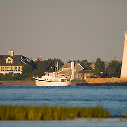Lynde Point Light in Old Saybrook, Connecticut, as seen from across the mouth of the Connecticut River in Old Lyme.  The Nature Conservancy's Griswold Point Preserve.