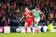 Celtic forward Moussa Dembele (#10) and Aberdeen defender Andrew Considine (#4) wrestle for possession during the Scottish Cup final match between Aberdeen and Celtic at Hampden Park, Glasgow, United Kingdom on 27 November 2016. Photo by Craig Doyle.