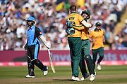 Matthew Carter and Tom Moores of Notts Outlaws celebrate the wicket of Bret D'Oliveira during the Vitality T20 Finals Day 2019 match between Notts Outlaws and Worcestershire Rapids at Edgbaston, Birmingham, United Kingdom on 21 September 2019.