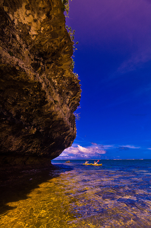 Sea kayaking by a grotto, Vatulele Island Resort, Fiji Islands