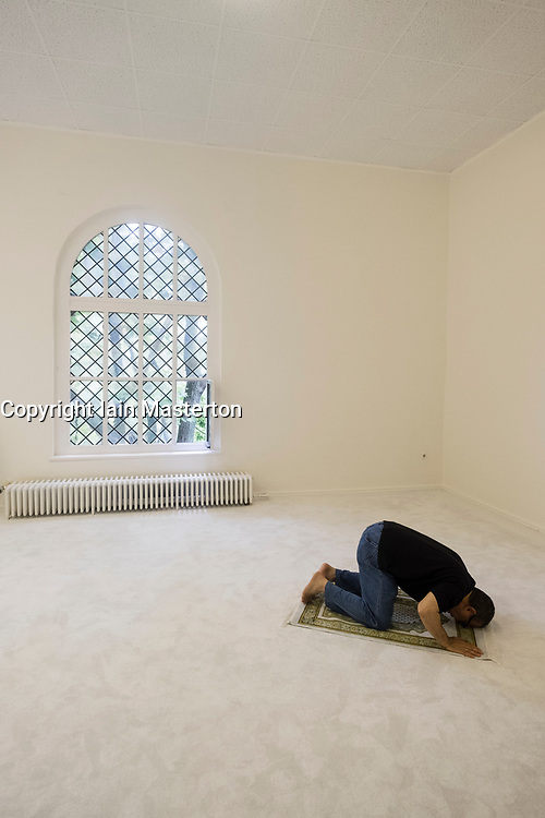 Man praying inside Ibn Rushd-Goethe mosque in St Johannis Church in Berlin. Founded by Seyran Ateş, it is a liberal mosque open to both men and women.