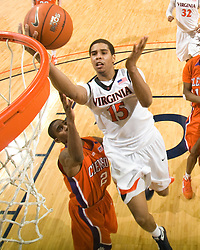 Virginia guard Sylven Landesberg (15) finishes a layup past Clemson guard Demontez Stitt (2).  The Virginia Cavaliers defeated the #12 ranked Clemson Tigers in overtime 85-81 at the John Paul Jones Arena on the Grounds of the University of Virginia in Charlottesville, VA on February 15, 2009.